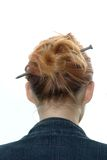 Hairdress with a metal nail Stock Image