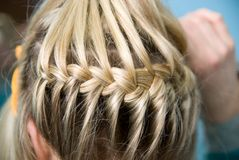 Hairdress a plait Stock Images