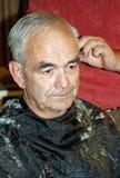 Hairdresser. Elder gentleman having a haircut Stock Photo