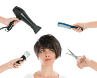 Hairdresser. Young beautiful woman thinking with hairdresser tools among her isolated on white background Stock Images