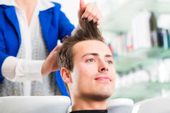 Hairdresser advice man on haircut in barbershop Royalty Free Stock Image