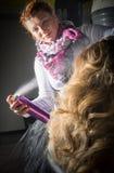 Hairdresser applying hair spray on ombre hair Royalty Free Stock Photos