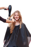 Hairdresser blow dry hair Stock Images