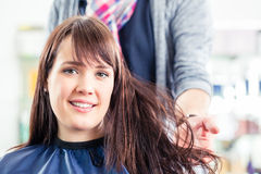 Hairdresser blow dry woman hair Royalty Free Stock Images
