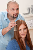 Hairdresser choose hair dye color at salon Stock Images