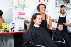 Hairdresser with client in beauty salon Stock Images