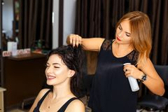 Hairdresser and client in the salon, beauty salon and hair care royalty free stock photos