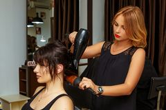 Hairdresser and client in the salon, beauty salon and hair care stock photography
