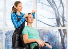 Hairdresser and client Royalty Free Stock Images