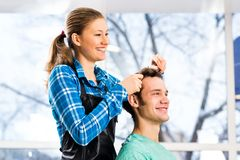 Hairdresser and client Royalty Free Stock Photos