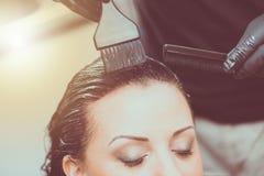 Hairdresser coloring hair, light effect Stock Photos
