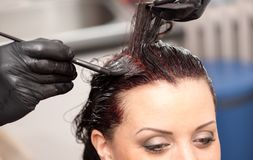 Hairdresser coloring hair Stock Photo