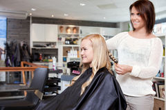 Hairdresser Curling Customer's Hair Royalty Free Stock Images