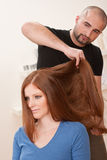 Hairdresser with customer at salon Stock Photo