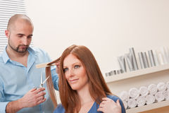 Hairdresser cut with scissors at salon Stock Photos