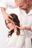 Hairdresser cut with scissors at salon Stock Image