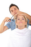 Hairdresser cut senior woman hair royalty free stock photography