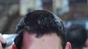 Hairdresser Cuts the Hair of a Young Man with Clipper at Home stock video footage