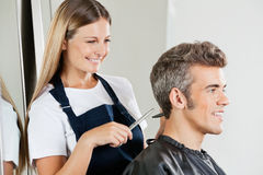 Hairdresser Cutting Customer's Hair Stock Photos