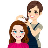 Hairdresser Cutting Fringe. Professional hairdresser cutting fringe with scissors to beautiful curly hair brunette girl stock illustration