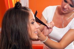 Hairdresser cutting hair of beautiful girl Stock Photography