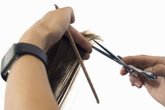 Hairdresser cutting hair, close-up of comb and scissors, cut out Stock Photo