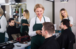 Hairdresser cutting hair of male Royalty Free Stock Image