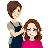 Hairdresser Cutting Hair Stock Images
