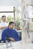 Hairdresser Cutting Man's Hair Stock Photos