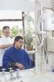 Hairdresser Cutting Man's Hair Stock Photos
