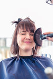 Hairdresser cutting woman hair in shop Stock Photo