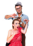 Hairdresser cutting woman's hair Stock Images