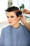 Hairdresser Cutting Woman's Hair in Beauty Salon. Haircut Stock Photography