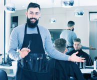 Hairdresser demonstrating his workplace Royalty Free Stock Image