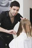 Hairdresser Dividing Client's Hair Before Haircut At Salon Royalty Free Stock Images