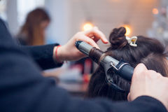 The hairdresser does a hair. The hairdresser does hair dressing Stock Photo
