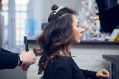 The hairdresser does a hair. The hairdresser does hair dressing Royalty Free Stock Image