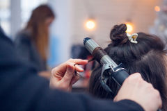 The hairdresser does a hair. The hairdresser does hair dressing Royalty Free Stock Photos