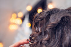 The hairdresser does a hair Royalty Free Stock Images