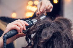 The hairdresser does a hair. The hairdresser does hair dressing Stock Photography