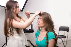 Hairdresser does hair style of woman in Stock Photo