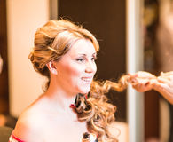 The hairdresser does a hairstyle to the bride Royalty Free Stock Images