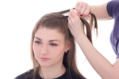 Hairdresser doing haircut to beautiful woman isolated on white Royalty Free Stock Photos