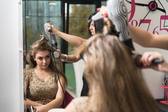 Hairdresser Doing Haircut For Woman In Hairdressing Salon Stock Image