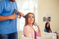 Hairdresser doing haircut for women in hairdressing salon. Conce Royalty Free Stock Photography