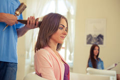 Hairdresser doing haircut for women in hairdressing salon. Conce Stock Image