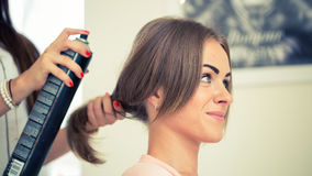 Hairdresser doing haircut for women in hairdressing salon. Conce Stock Images