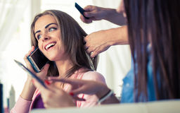 Hairdresser doing haircut for women in hairdressing salon. Conce Royalty Free Stock Photos