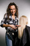 Hairdresser doing her job Royalty Free Stock Images