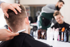 Hairdresser doing new haircut Royalty Free Stock Photo